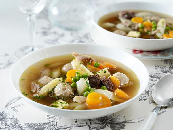 [Image description: a table set with a bowl of soup with vegetables and chicken] Via Pinterest