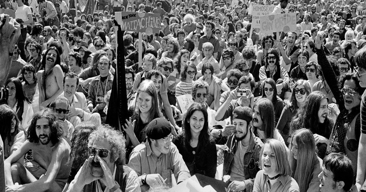 [Image description: Festivities at the first gay pride parade in 1970.] Via nytimes.com