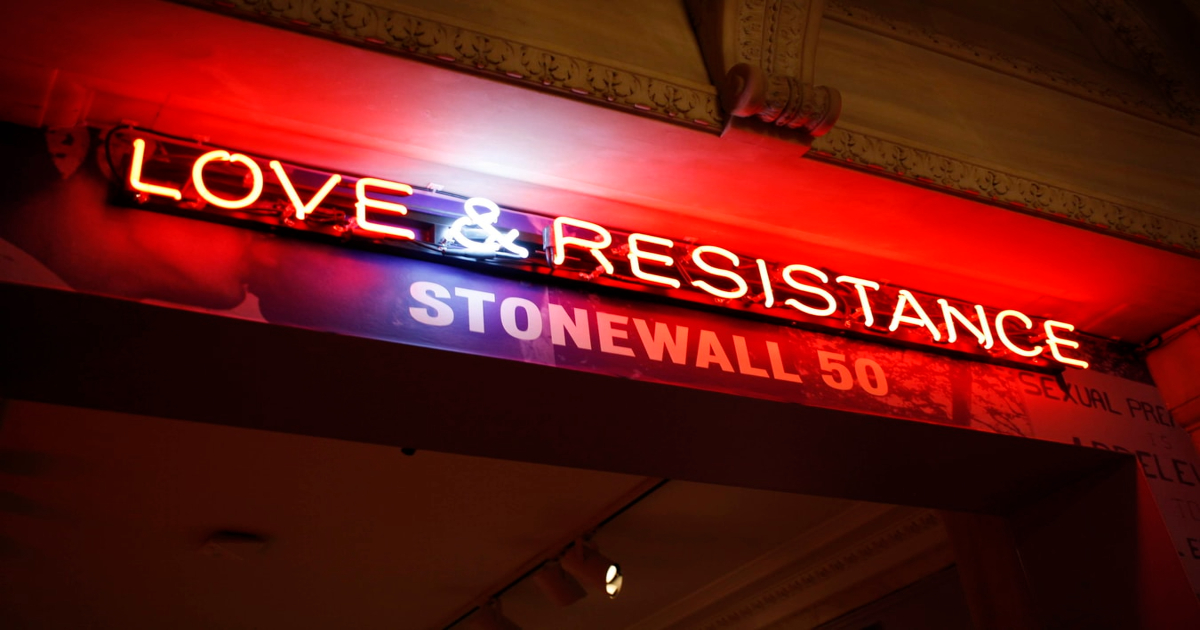 [Image description: A sign commemorating what the Stonewall Inn represents for gay rights.] Via Unsplash