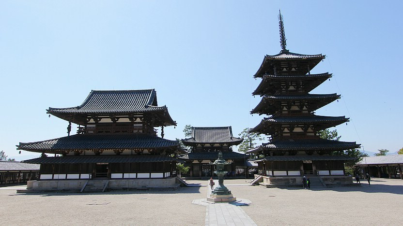 [Image description: Horyuji Temple, which was built during the rise of Buddhism in Japan, towering against a blue sky.] Via japan-guide.com