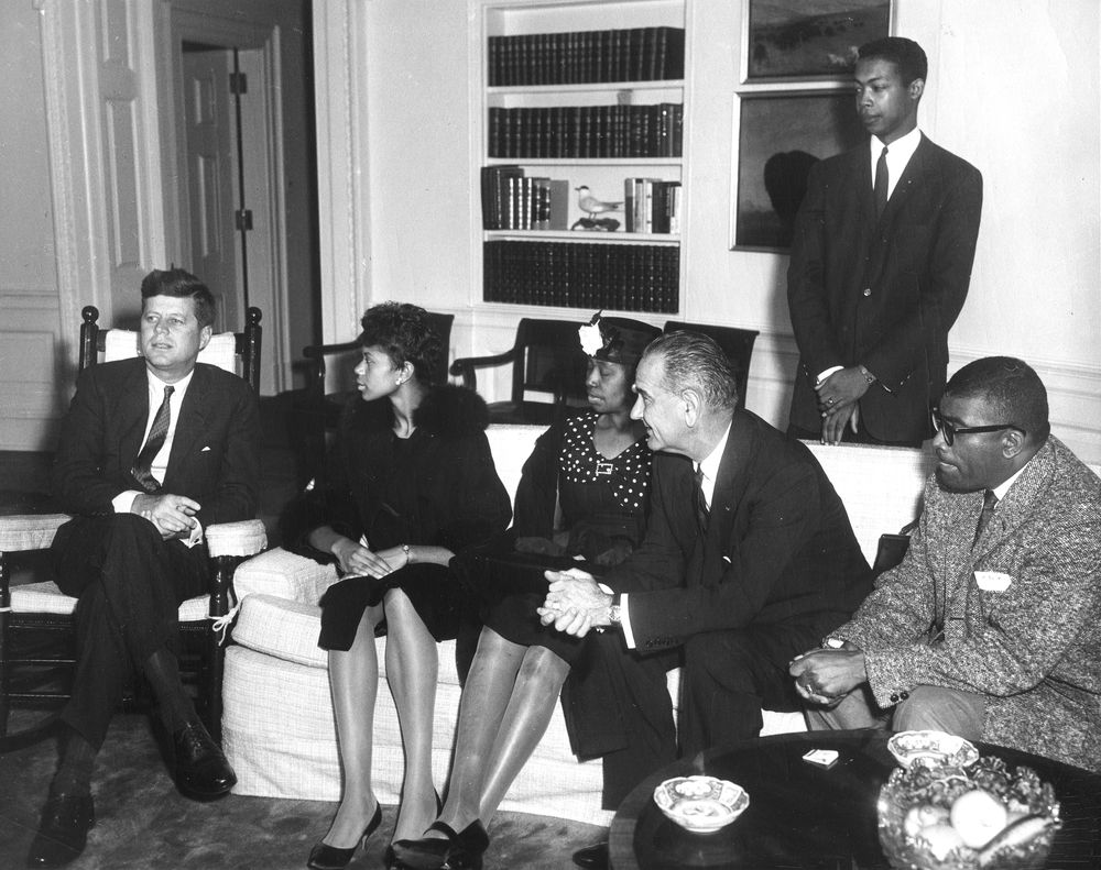 [Image description: Wilma Rudolph sitting next to President John F. Kennedy on a visit to the White House.] Via jfklibrary.org